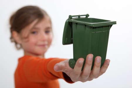 tied hair: Girl holding recycling bin