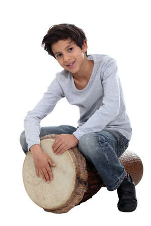 rawhide: Young boy playing the djembe Stock Photo