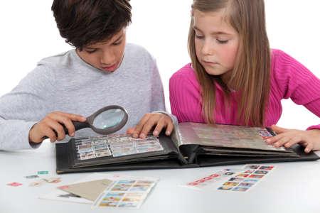 philatelic: Kids watching a stamps album
