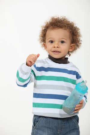 Toddler with milk bottle photo