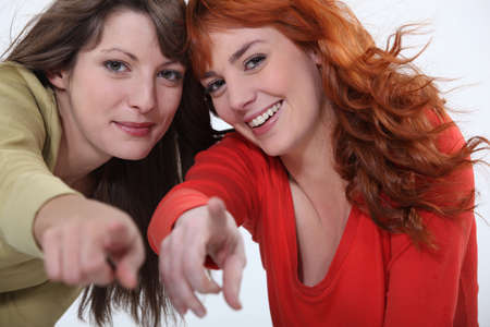 mocking: Two attractive women pointing fingers