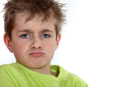 Portrait of a pouting boy photo