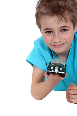 Boy with a toy car photo
