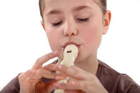 flute music: Little girl playing the recorder