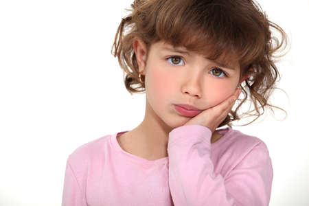 sulking: Cute little girl pouting Stock Photo