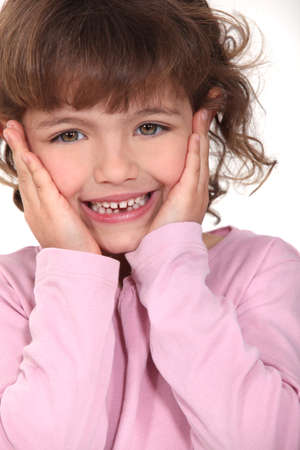shy girl: Shy little girl Stock Photo