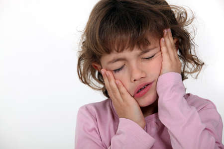 drowsiness: Girl clutching her face