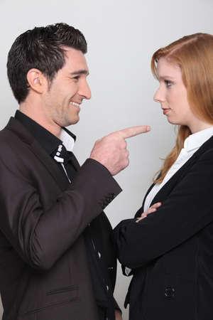 banter: Man making fun of a woman