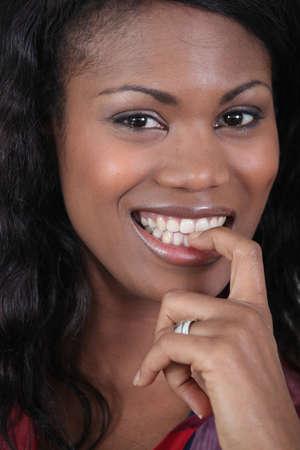 close-up shot of black woman photo