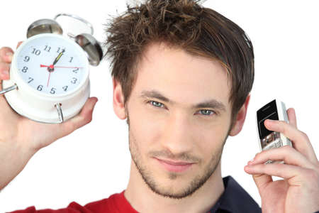 hurry up: Man stood alarm clock and mobile