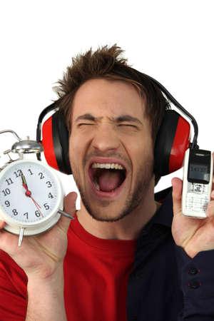 life balance: Man in distress regarding time Stock Photo