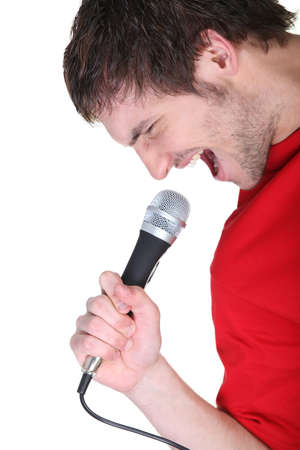 kareoke: Man singing into microphone