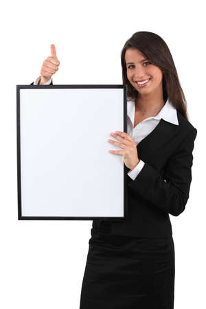 look pleased: woman holding a white board