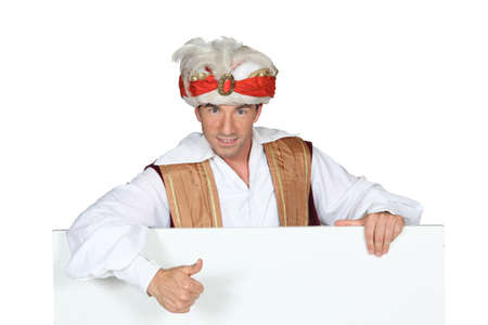Man in a fancy dress turban giving the thumbs up to a board left blank for your image Stock Photo - 15232990
