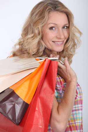 Woman holding two shopping bags photo