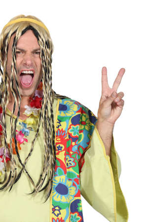 Enthusiastic man in a hippy costume Stock Photo - 15234255