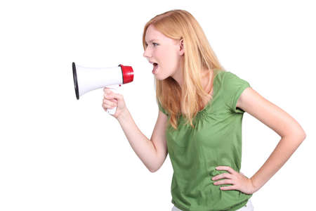 profile view: Profile view of young woman shouting into megaphone