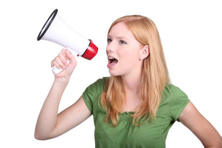 Young woman with a loudspeaker Stock Photo