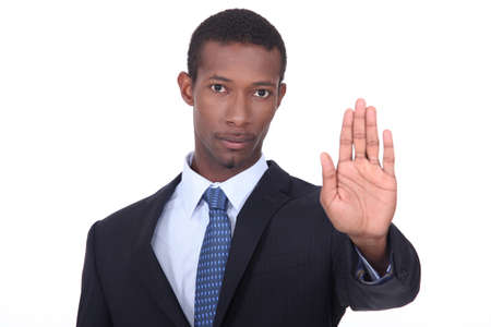 A businessman making a stop gesture. Stock Photo - 15233227