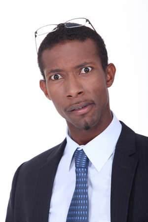 man in suite: Afro-American businessman looking surprised Stock Photo