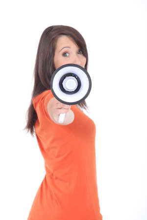 profile view: Profile view of young woman holding megaphone