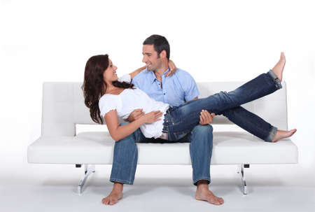 Happy couple on white sofa photo