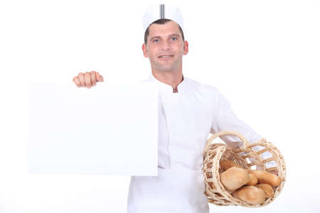 A baker holding a white poster. photo