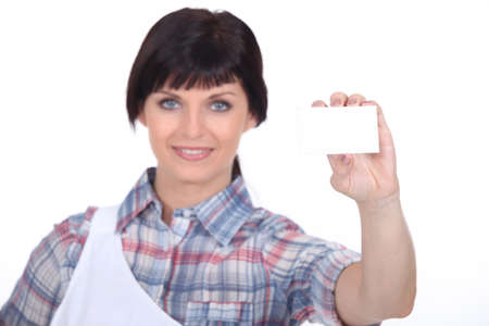 Butcher holding up her business card Stock Photo - 15232830