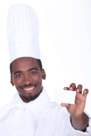 hospitality industry: Chef holding up his restaurants business card