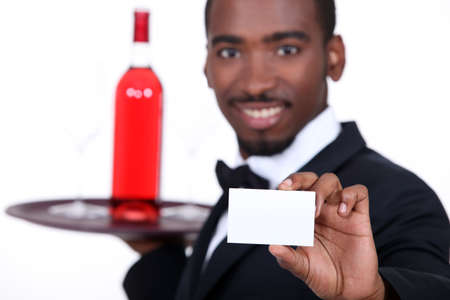 Waiter with a bottle of rose wine and a blank business card photo