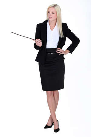 domination: sexy businesswoman holding a stick