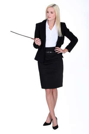 dominacion: sexy mujer de negocios la celebración de un palo