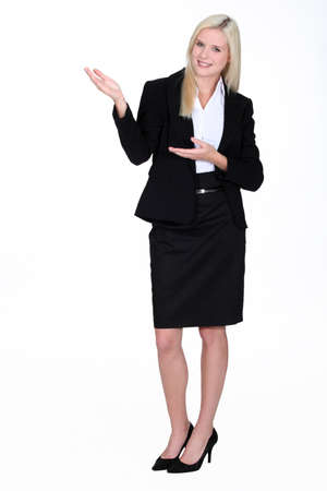 preppy: full-body portrait of gorgeous blonde businesswoman Stock Photo