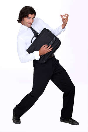 air guitar: Man with briefcase Stock Photo