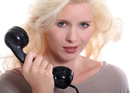 Woman with an old-fashioned telephone handset photo