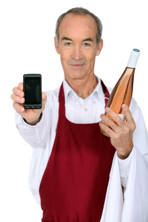 Man with a bottle of wine and a phone left blank for your message photo