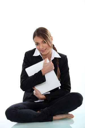 A cute businesswoman hugging a file