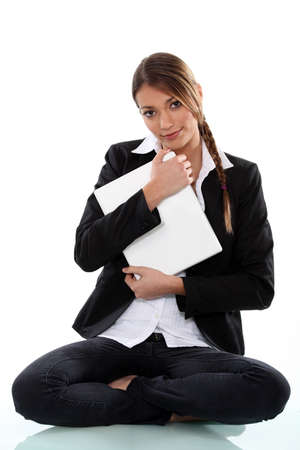 to tight: Woman protecting her laptop