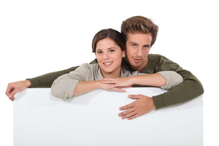 20 years old man and woman, man is surrounding the woman with his arms Stock Photo - 15263048
