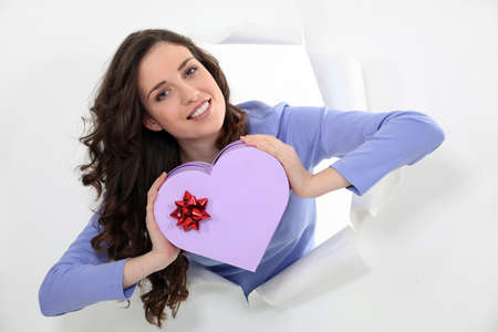 Woman holding a heart-shaped box photo