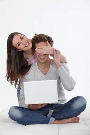 joking: Couple with a laptop computer Stock Photo