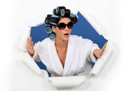 Surprised woman in hair rollers photo
