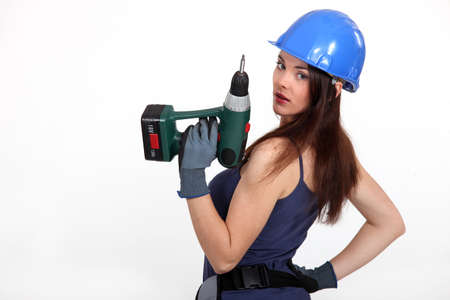 sexy construction worker: Woman with a power drill