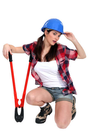 tradeswoman: Tired tradeswoman holding clippers Stock Photo