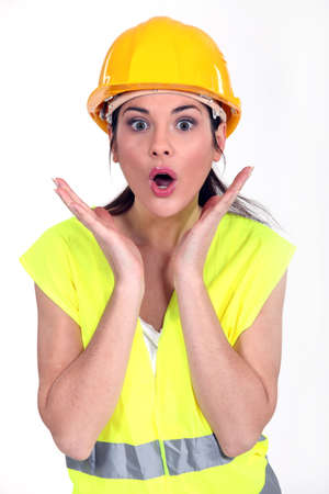 astonished: A surprised female manual worker