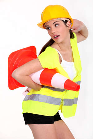 signaling: Sexy woman with traffic cones