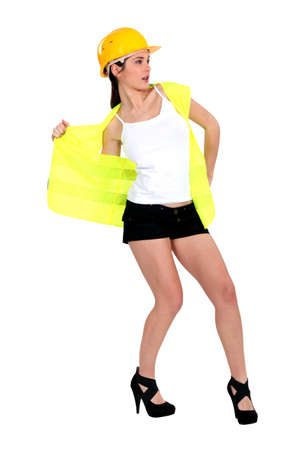 yourselfer: Woman taking off her reflective worker vest