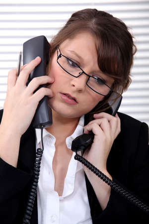 switchboard: Overworked receptionist answering telephones