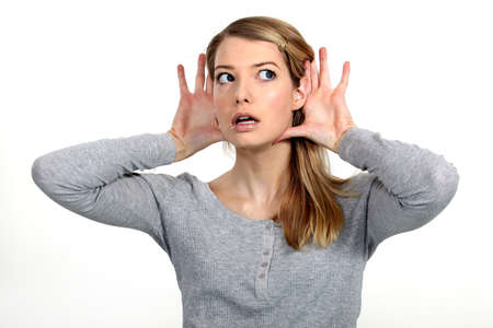 unwillingness: Blond woman struggling to hear