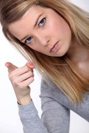 angry blonde: Woman shaking her finger Stock Photo